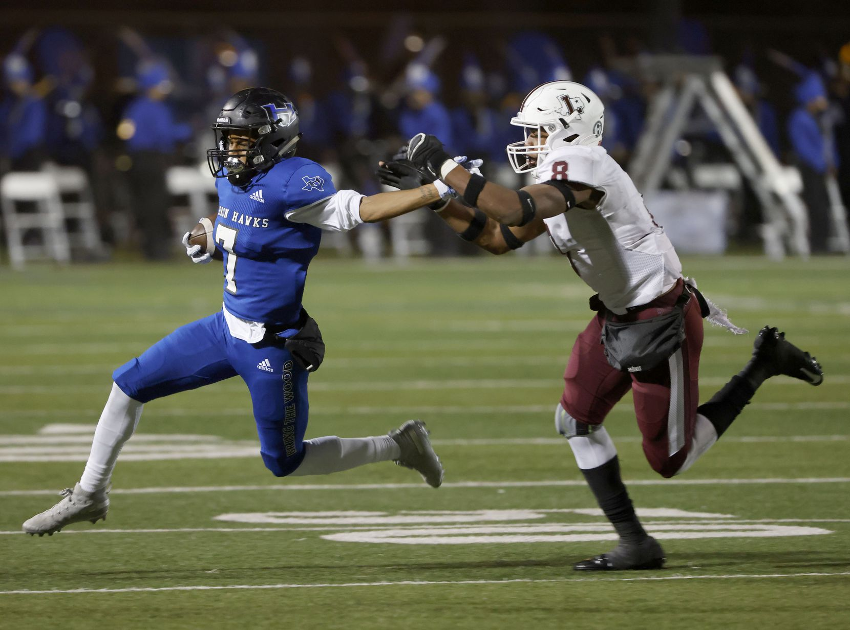 Hebron Hawks' Trenton Bronaough tries to get past Lewisville's Davis Adegbenro (8) during their District 6-6A high school football game on Dec. 4, 2020. (Michael Ainsworth/Special Contributor)
