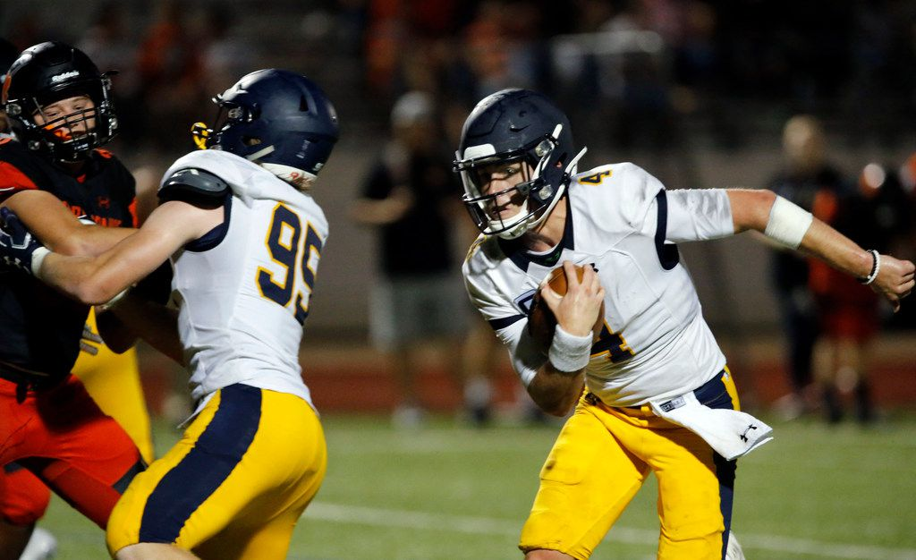 Highland Park quarterback Chandler Morris (4) finds an opening and heads to the end zone for a touchdown, the final of a pair of late-game touchdowns, to seal a 66-59 win over Rockwall on Friday, August 30, 2019. (John F. Rhodes / Special Contributor)