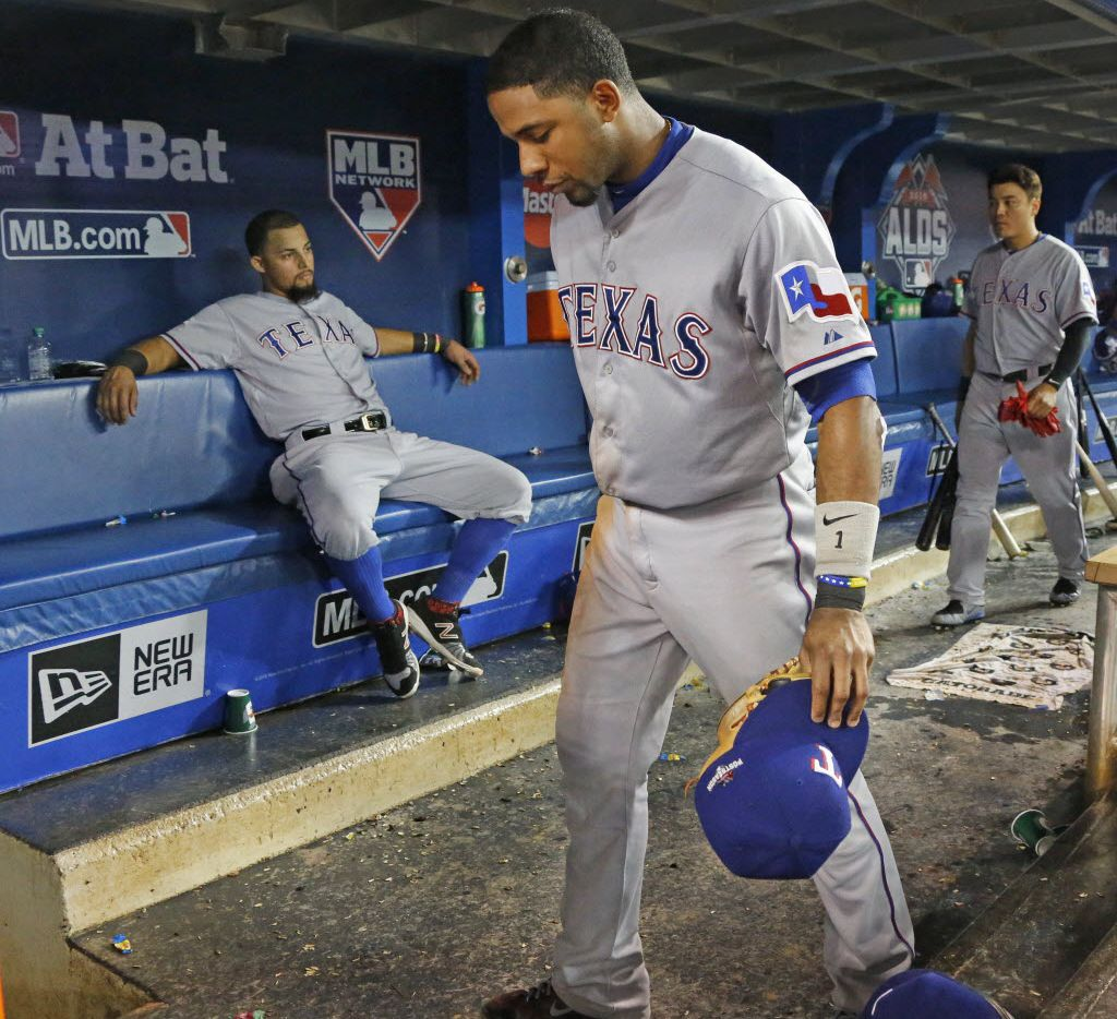 Texas Rangers Rougned Odor, left, Elvis Andrus,center, and Shin-Soo Choo are pictured in the otherwise empty dugout after the Rangers lost 6-3 during Game 5 of the ALDS between the Texas Rangers and the Toronto Blue Jays at Rogers Centre in Toronto, Canada on Wednesday, October 14, 2015. (Louis DeLuca/The Dallas Morning News)