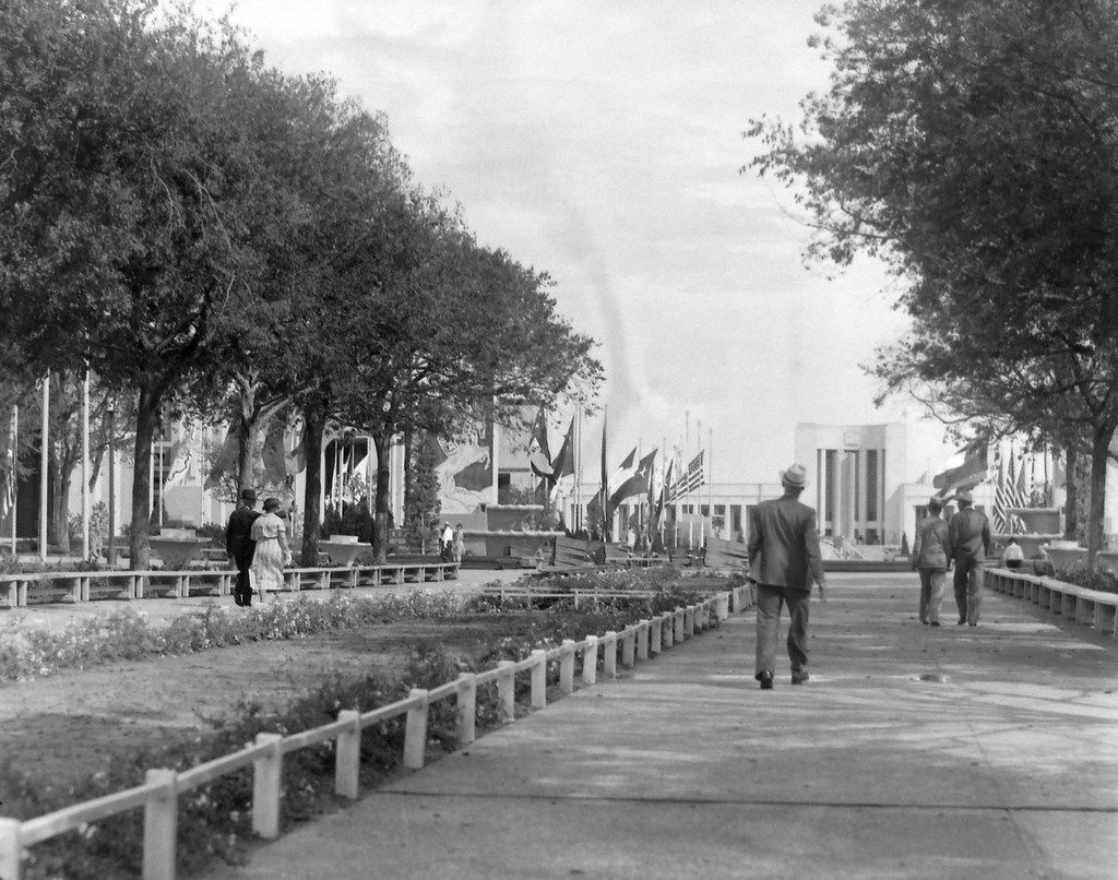 An undated photo of people strolling along the Esplanade with the Hall of State in the background