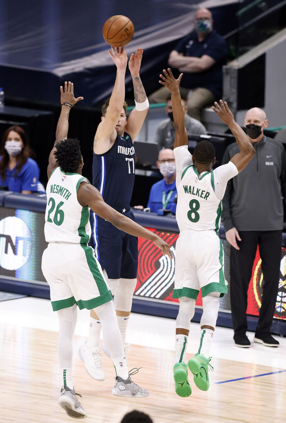 Dallas Mavericks guard Luka Doncic (77) takes the game-winning shot over Boston Celtics forward Aaron Nesmith (26) and guard Kemba Walker (8) during the fourth quarter at the American Airlines Center in Dallas, Tuesday, February 23, 2021.