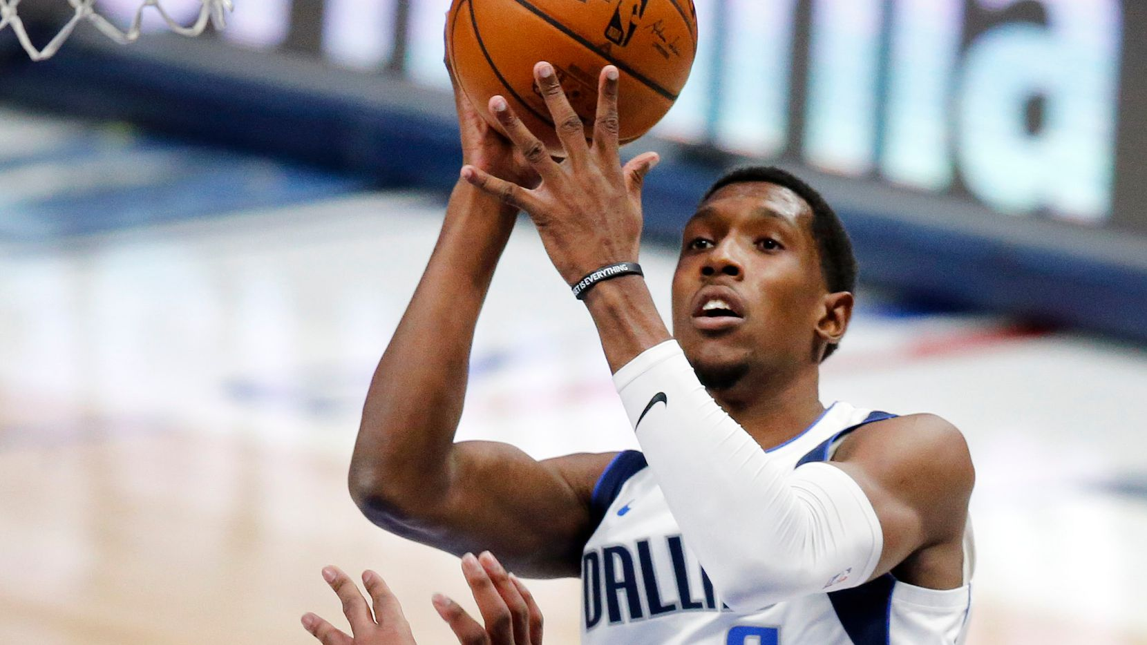 Dallas Mavericks guard Josh Richardson (0) puts up a shot over Minnesota Timberwolves forward Josh Okogie (20) during the first quarter of their preseason game at the American Airlines Center in Dallas, Thursday, December 17, 2020.