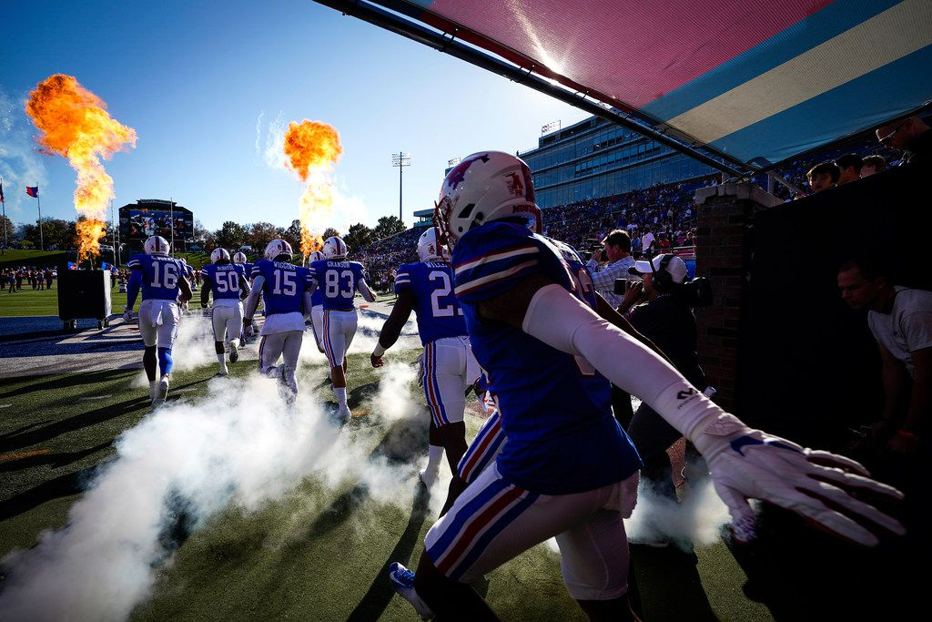 SMU player take the field to face Tulane in an NCAA football game at Ford Stadium on Saturday, Nov. 30, 2019, in Dallas. (Smiley N. Pool/The Dallas Morning News)