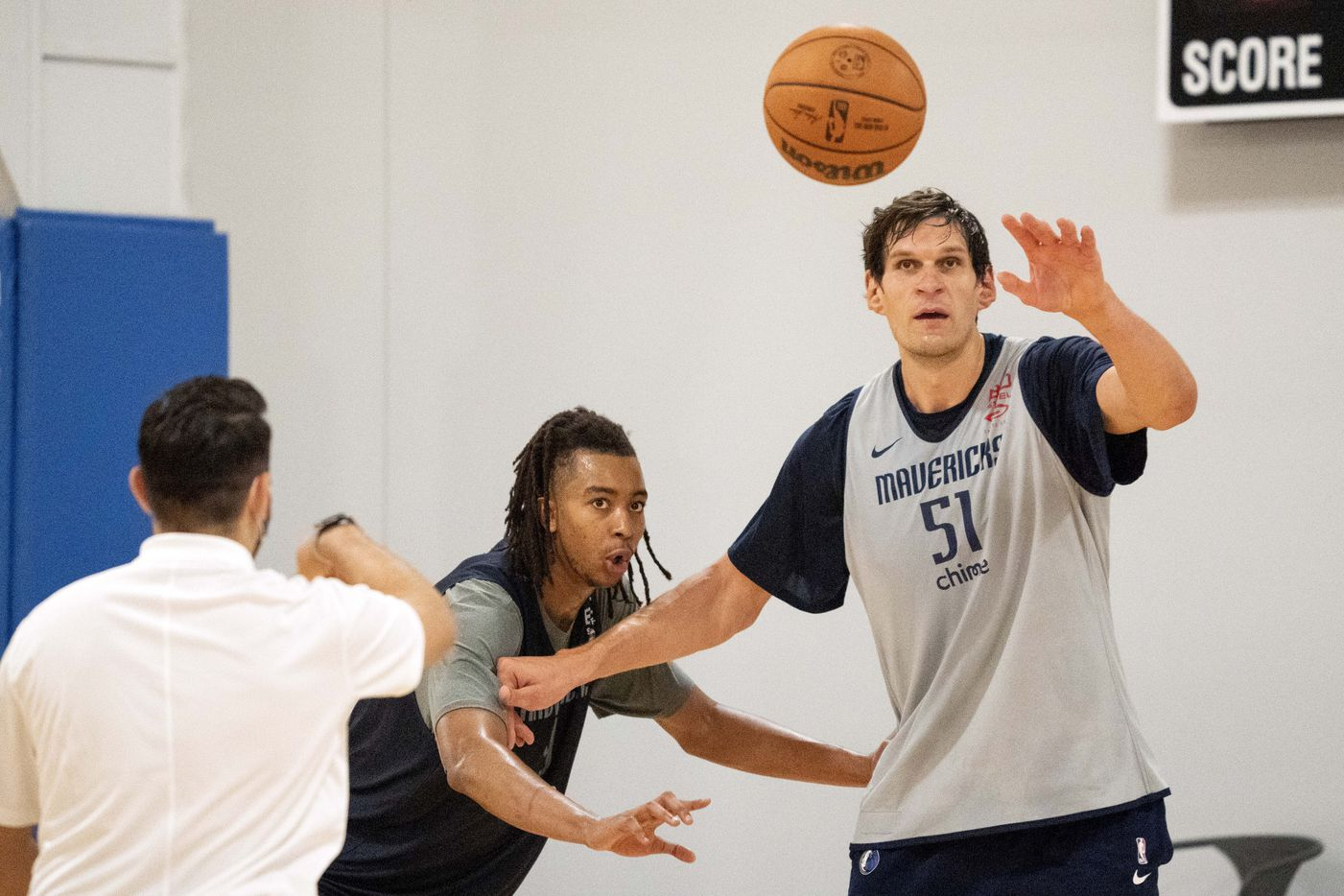 Dallas Mavericks centers Moses Brown, left, and Boban Marjanović (51) compete in a one-on-one drill during a training camp practice Wednesday, September 29, 2021 at the Dallas Mavericks Training Center in Dallas. (Jeffrey McWhorter/Special Contributor)