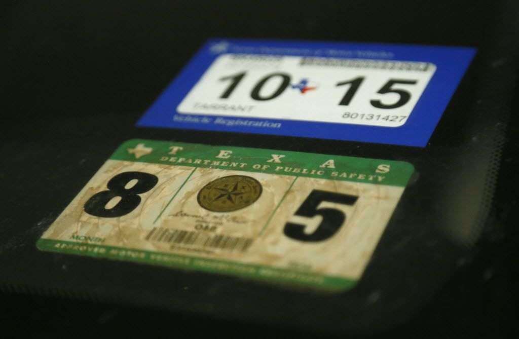 Texas Vehicle Registration Sticker (above) and Texas State Inspection Certificate Sticker (bottom) pictured in February 2015. (Kye R. Lee/The Dallas Morning News)
