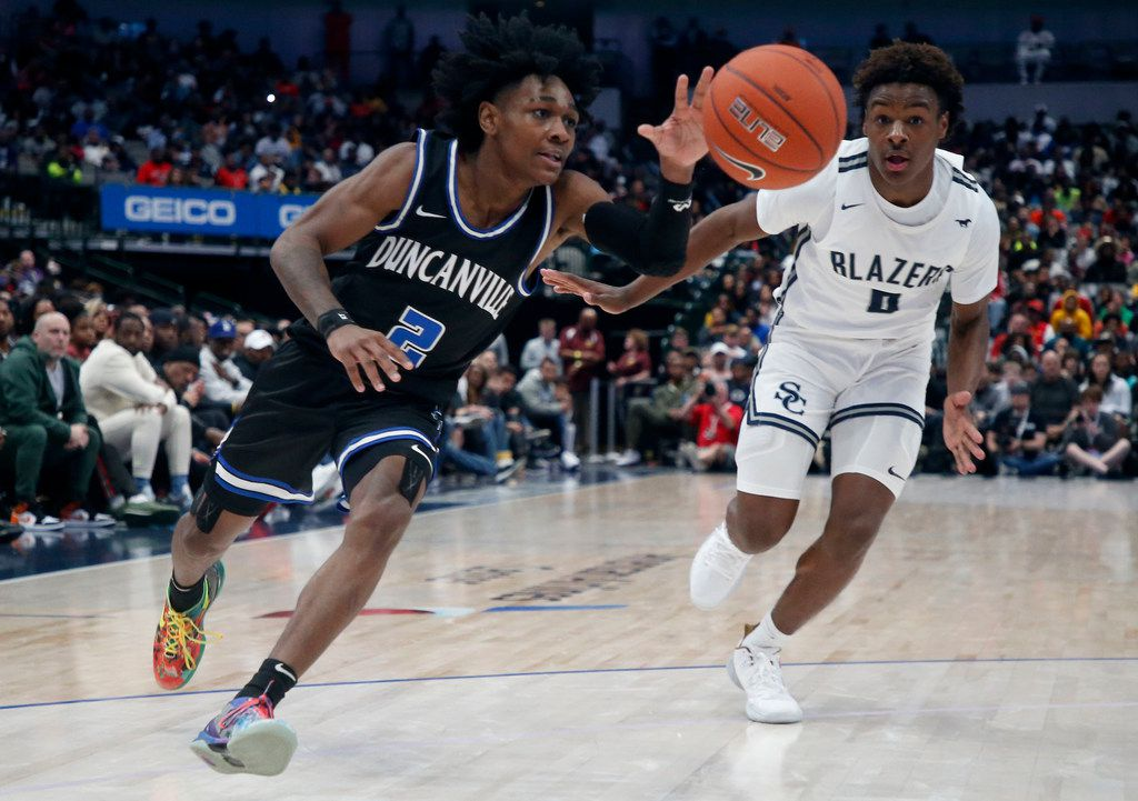 Duncanville's Ja'Bryant Hill  (2) drives past  Sierra Canyon's Bronny James (0) during their high school boys basketball game during the Thanksgiving Hoopfest in Dallas, Tx, Saturday, Nov. 30, 2019. (Michael Ainsworth)