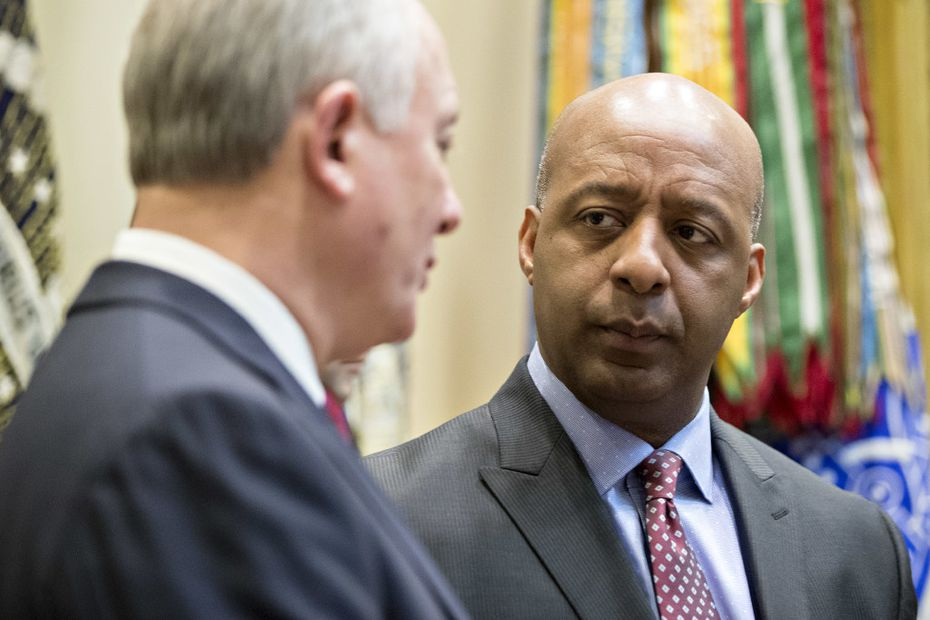 Marvin Ellison, right, talks with Greg Sandfort, CEO of Tractor Supply Co., before a listening session with President Donald Trump at the White House this month. (Andrew Harrer-Pool/Getty Images)