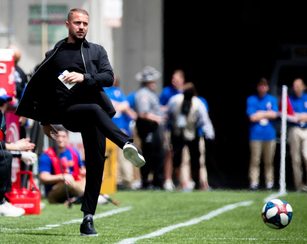 FC Cincinnati head coach Yoann Damet kicks a ball onto the field during an MLS soccer match against the Montreal Impact, Saturday, May 11, 2019, in Cincinnati, Ohio. (Albert Cesare/The Cincinnati Enquirer via AP)