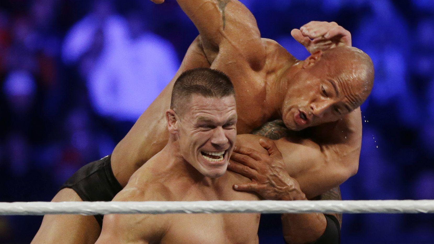 """John Cena y Dwayne Johnson """"The Rock""""/AP"""