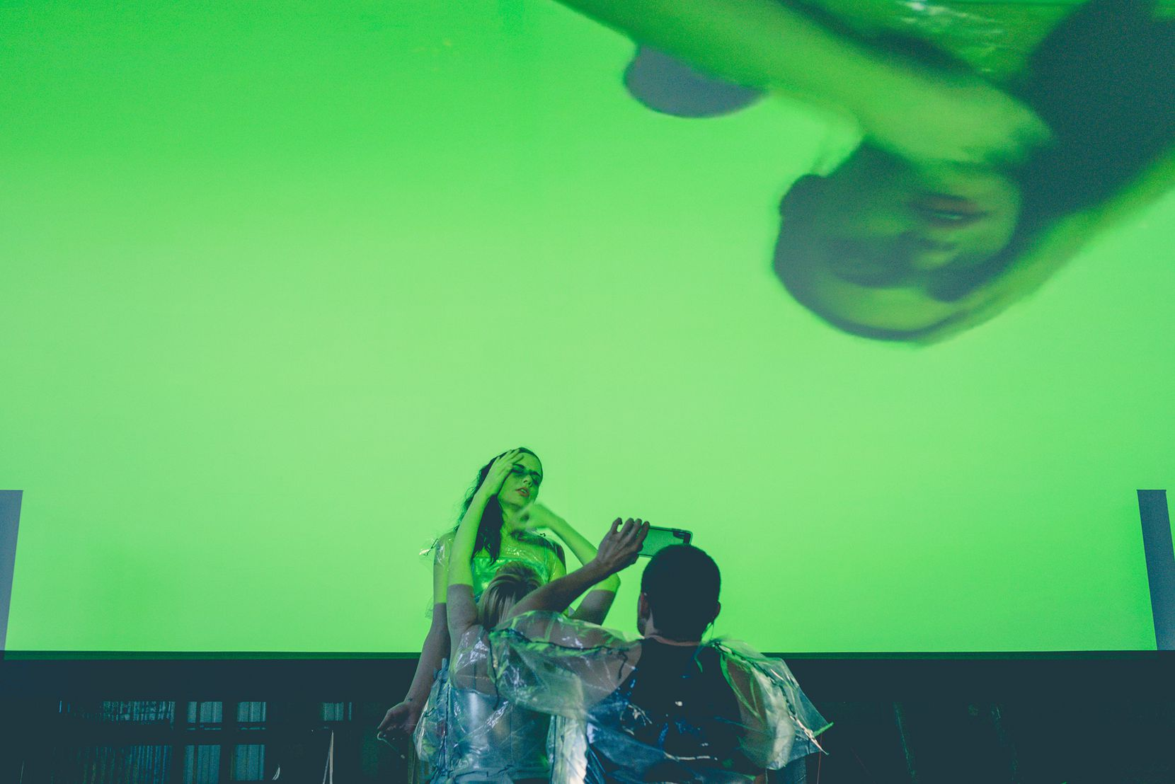 Performance artists movements are projected via live video from their phones during music performances.
