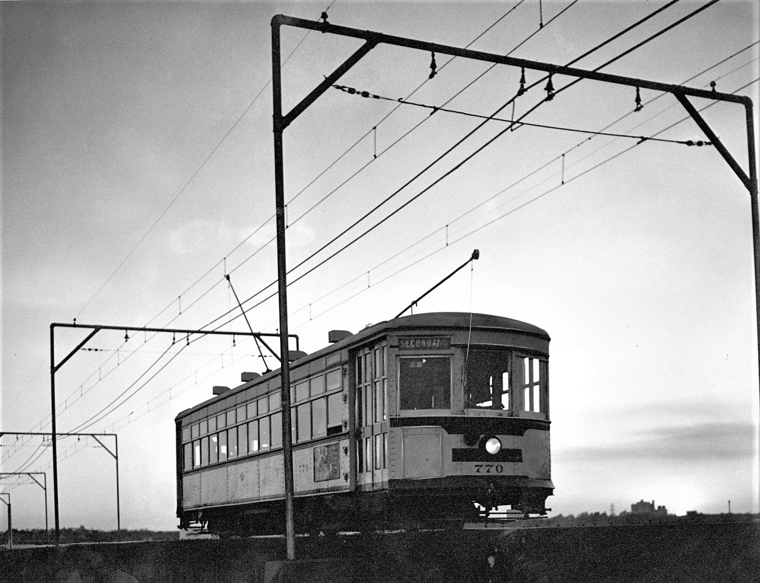 A streetcar comes over the Trinity River trestle as the sun goes down on a Saturday night in 1955.