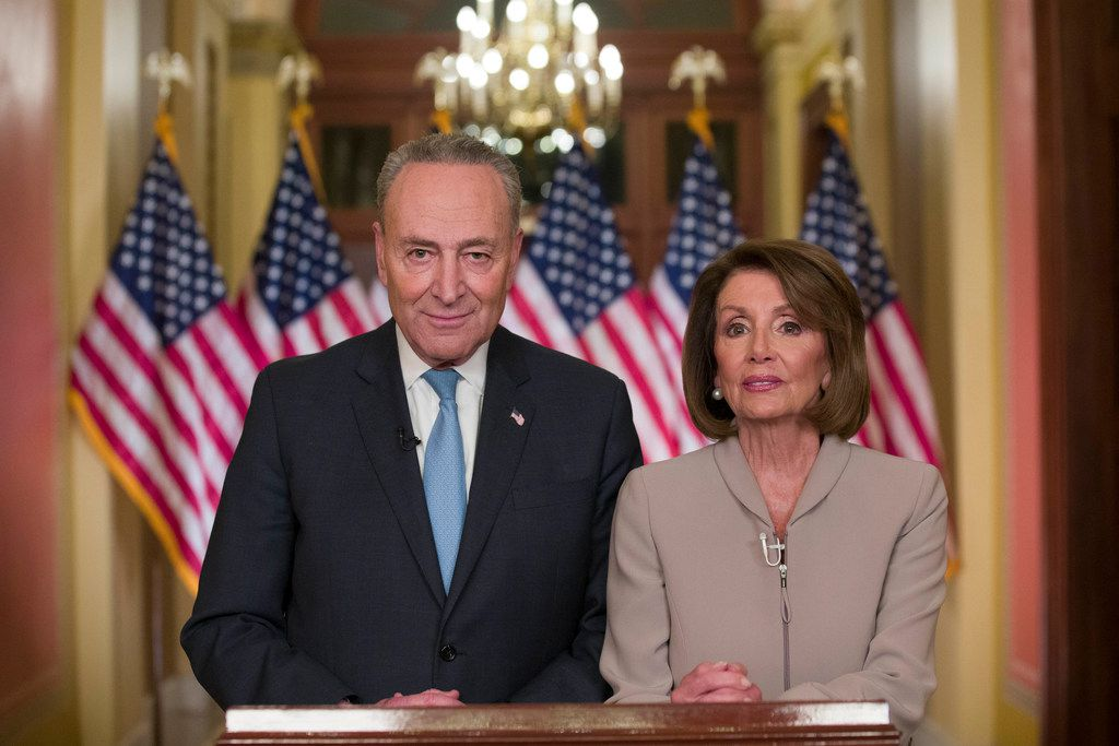 Senate Minority Leader Chuck Schumer of New York and House Speaker Nancy Pelosi of California pose for photographers after speaking on Capitol Hill in response President Donald Trump's address on Jan. 8, 2019, in Washington.