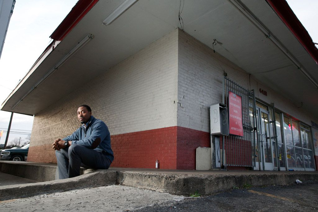 Taylor Toynes, an Oak Cliff community activist, sits at the Glendale Shopping Center corner where his grandfather once owned a convenience store.