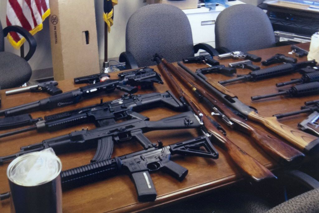 """This undated handout photo provided by the Prince George's, Md. County Police shows weapons found in the possession of a suspect who they say was plotting a shooting in his workplace. Police in Maryland say a man who called himself """"a joker"""" and threatened to shoot up his workplace was in the process of being fired. He was taken into custody for an emergency mental health evaluation and charges are pending."""