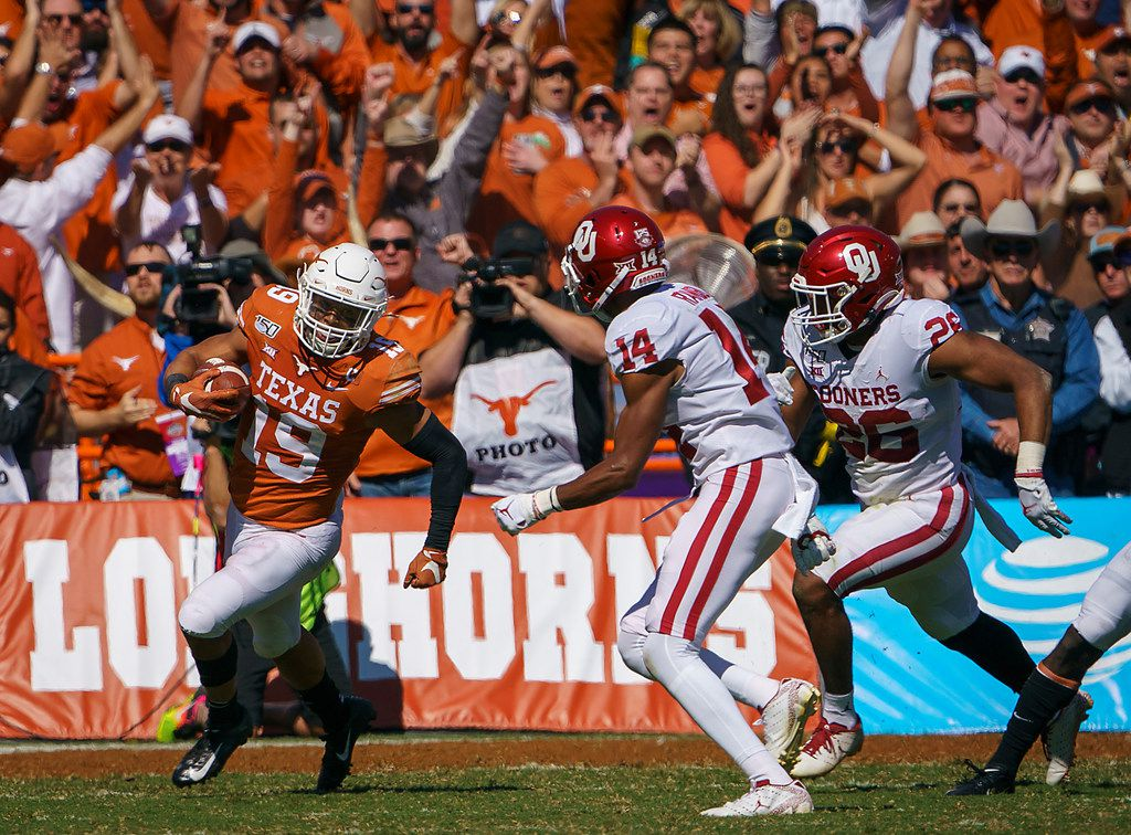FILE - Texas defensive back Brandon Jones (19) returns an interception during the first half of a game against Oklahoma at the Cotton Bowl on Saturday, Oct. 12, 2019, in Dallas.