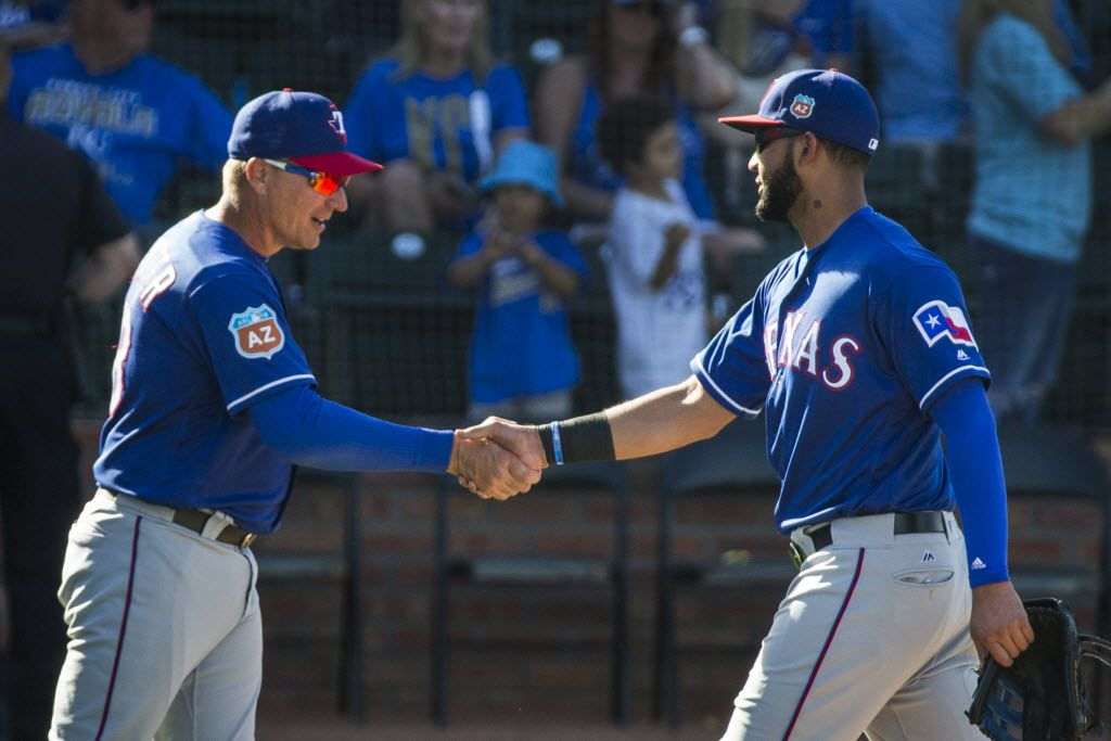 Texas Rangers outfielder Nomar Mazara gets a hand from manager Jeff Banister after a spring game against the Kansas City Royals at Surprise Stadium on Wednesday, March 2, 2016, in Surprise, Ariz. (Smiley N. Pool/The Dallas Morning News)