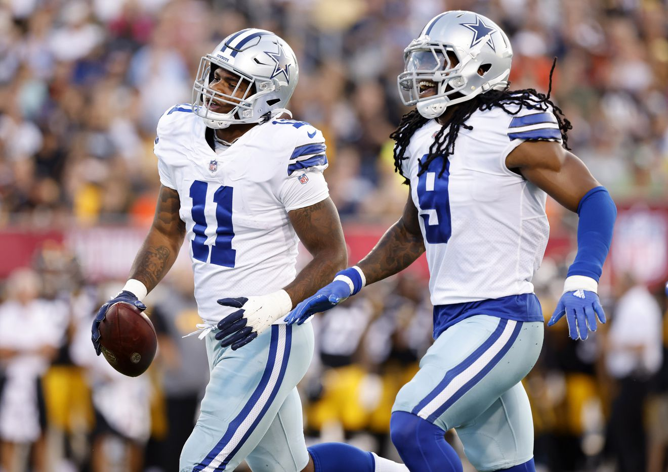 Dallas Cowboys linebacker Micah Parsons (11) celebrates his fumble recovery of Pittsburgh Steelers quarterback Mason Rudolph with teammate Jaylon Smith (9) during the first quarter of their preseason game at Tom Benson Hall of Fame Stadium in Canton, Ohio, Thursday, August 5, 2021. (Tom Fox/The Dallas Morning News)