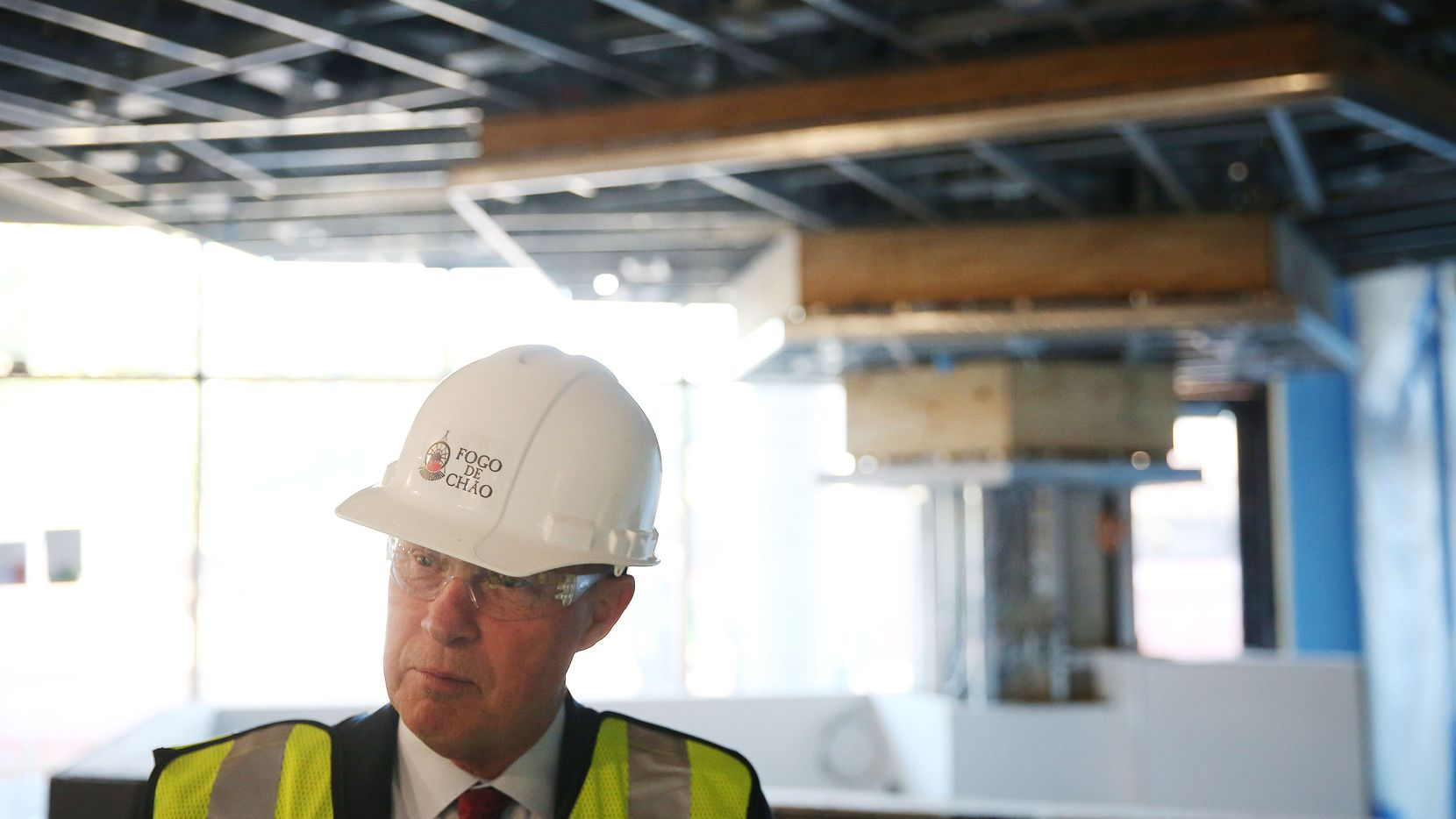 Lawrence Johnson, CEO of Fogo de Chão , gives The Dallas Morning News a tour of the space that will house the newest Fogo de Chao restaurant in the One Uptown building on the corner of Mckinney Avenue and Routh Street.  (Andy Jacobsohn/The Dallas Morning News)