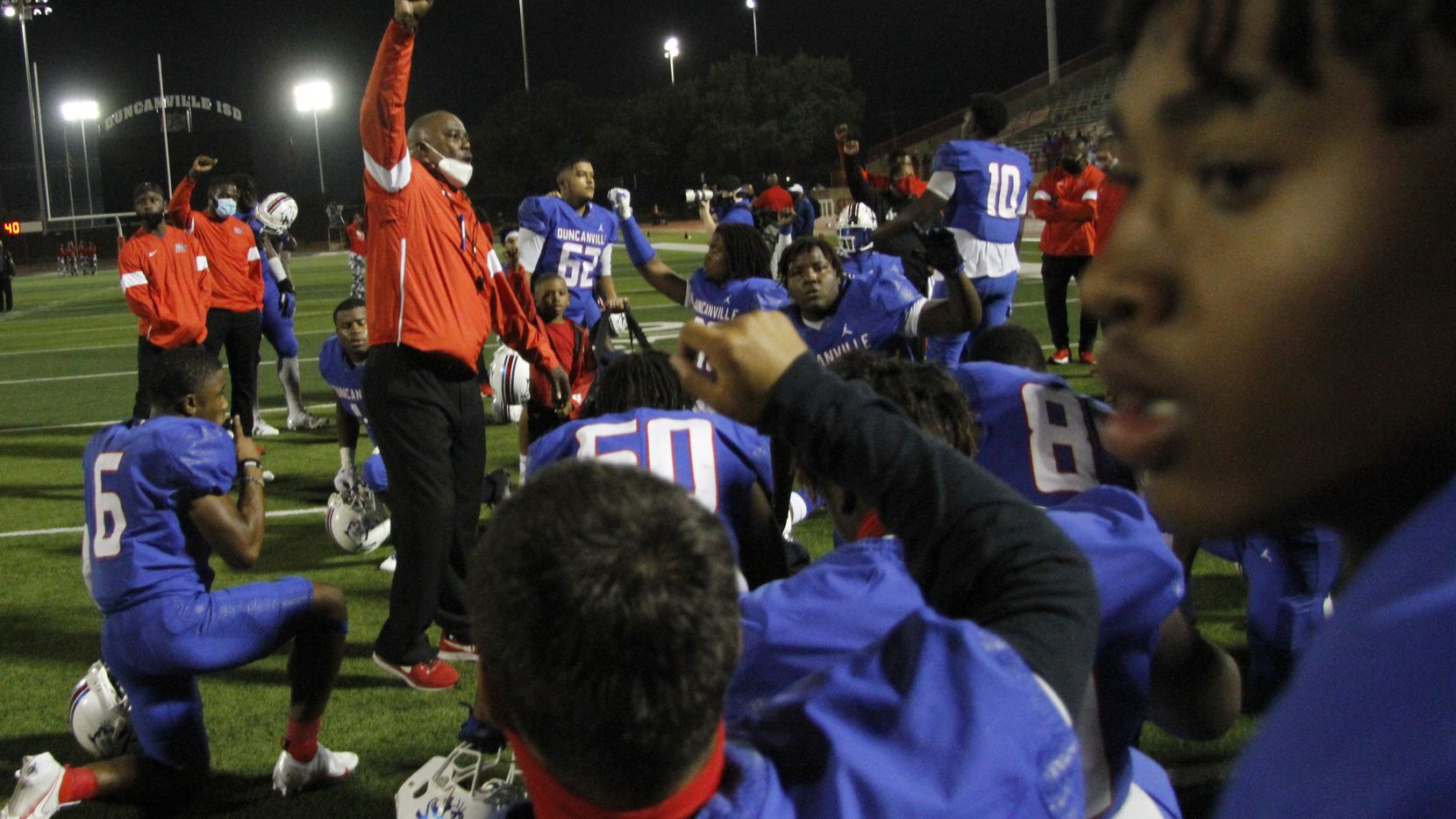 Duncanville head coach Reginald Samples delivers a motivational message to his players following their 28-14 victory over Cedar Hill. The two teams played their District 11-6A football game at Panther Stadium in Duncanville on November 13, 2020.