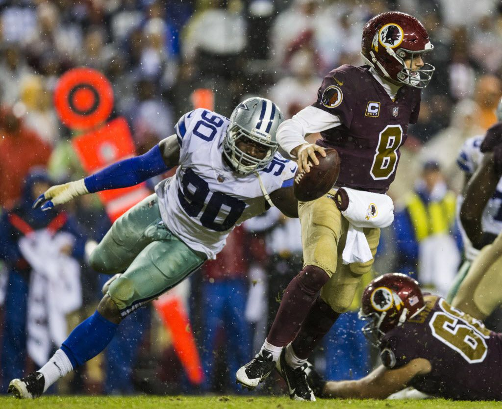 Dallas Cowboys defensive end Demarcus Lawrence (90) threatens Washington Redskins quarterback Kirk Cousins (8) during the third quarter of an NFL game between the Dallas Cowboys and the Washington Redskins on Sunday, October 29, 2017 at FedEx Field in Hyattsville, Maryland. (Ashley Landis/The Dallas Morning News)