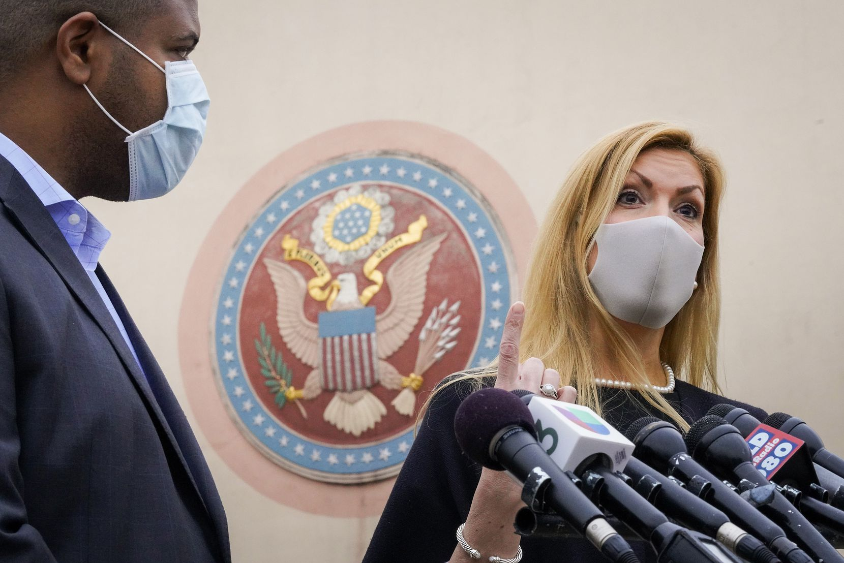 U.S. Rep. Beth Van Duyne and Dallas Mayor Eric Johnson address reporters outside the Tower Building after a tour of the Dallas County COVID-19 mega-vaccination site at Fair Park on Friday, Jan. 22, 2021, in Dallas. (Smiley N. Pool/The Dallas Morning News)