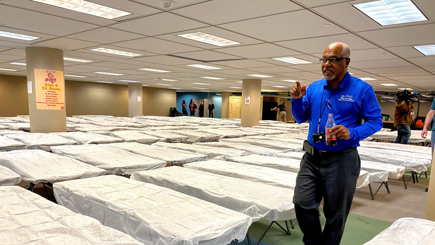 Winford Cross, Homeless Services Supervisor for the City of Dallas, counts cots at the Dallas Public Library in Dallas, Texas on Feb. 4, 2020. In preparation of cold weather, the city is opening a temporary shelter in the basement of the central library.