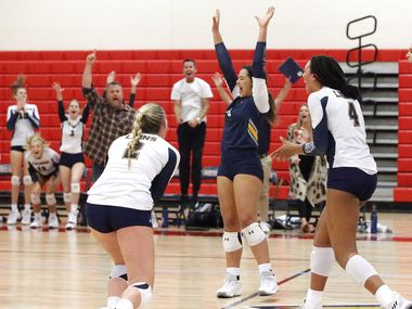 Plano Prestonwood Christian libero Gillian Pitts (8) reacts to winning the first set during Tuesday's three-set sweep of Plano John Paul II. It was the 13th consecutive win for Prestonwood. (Stewart F. House/Special Contributor)