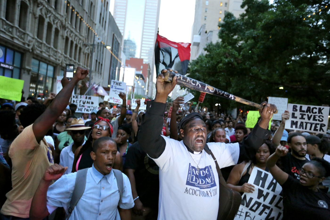 Protester Ernest Walker (front right) and others marched peacefully down Main Street in downtown Dallas on July 7, 2016. As the rally and march were winding down, Micah Xavier Johnson opened fire, killing five police officers.