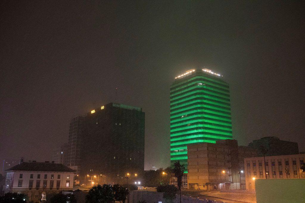Snow falls in downtown Corpus Christi on Texas, Friday, Dec. 8,2017.