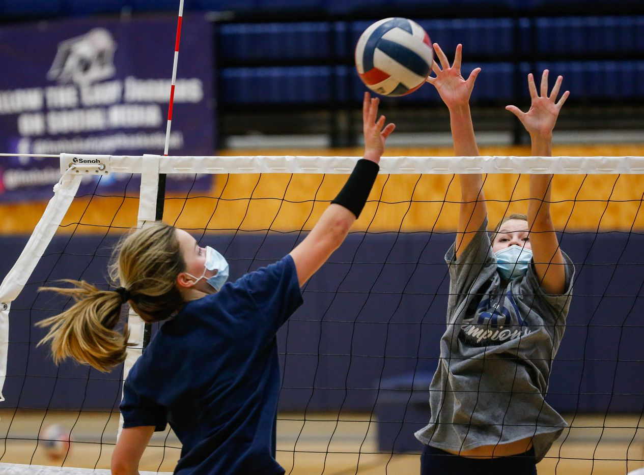 Flower Mound High School volleyball player Gabby Walker (right) goes up to block the ball during practice on Sept. 8, 2020 in Flower Mound. (Juan Figueroa/ The Dallas Morning News)