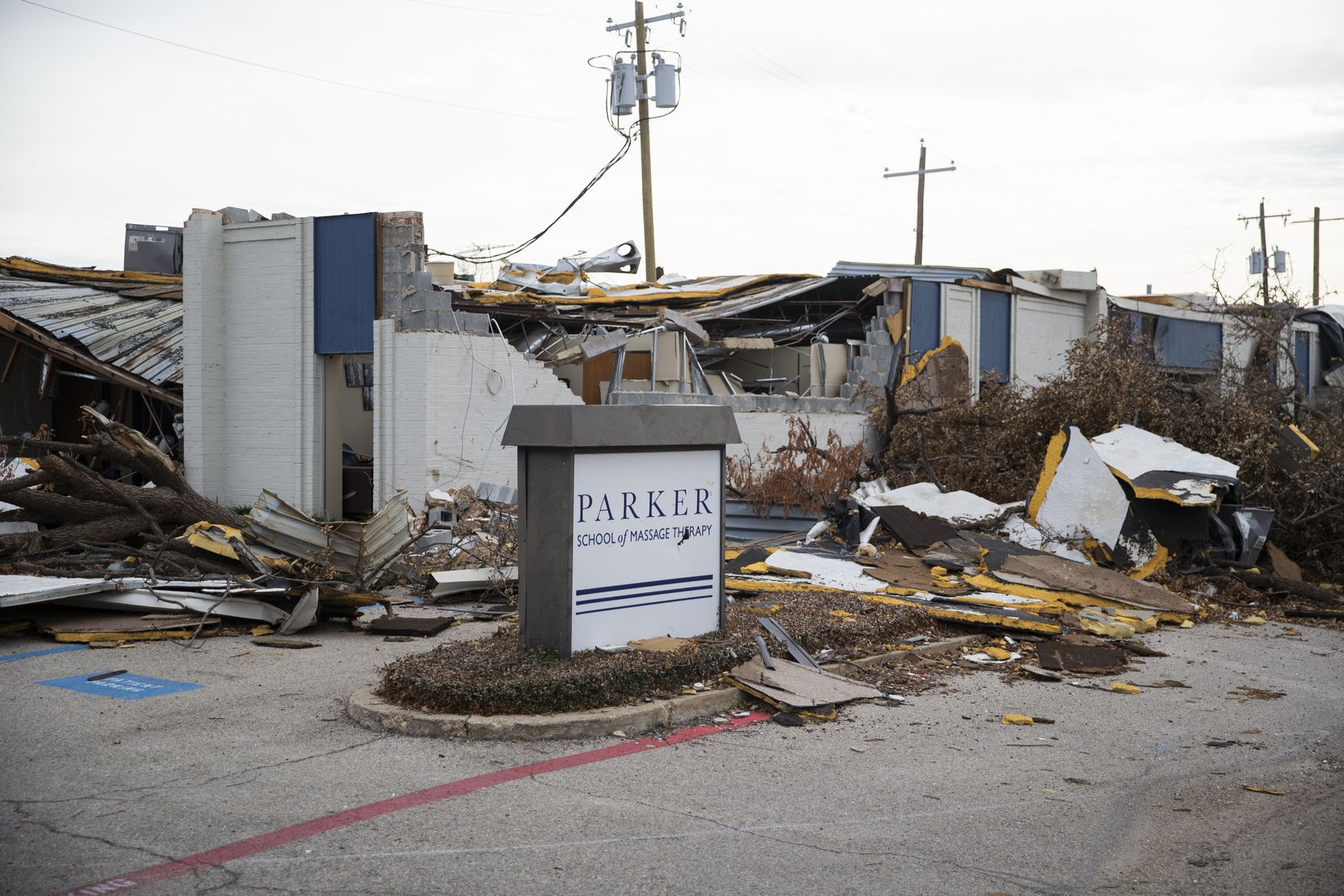 Parker University's School of Massage Therapy Clinic on Electronic Lane was one of many buildings on the campus along and near Walnut Hill Lane smashed by the October winds.