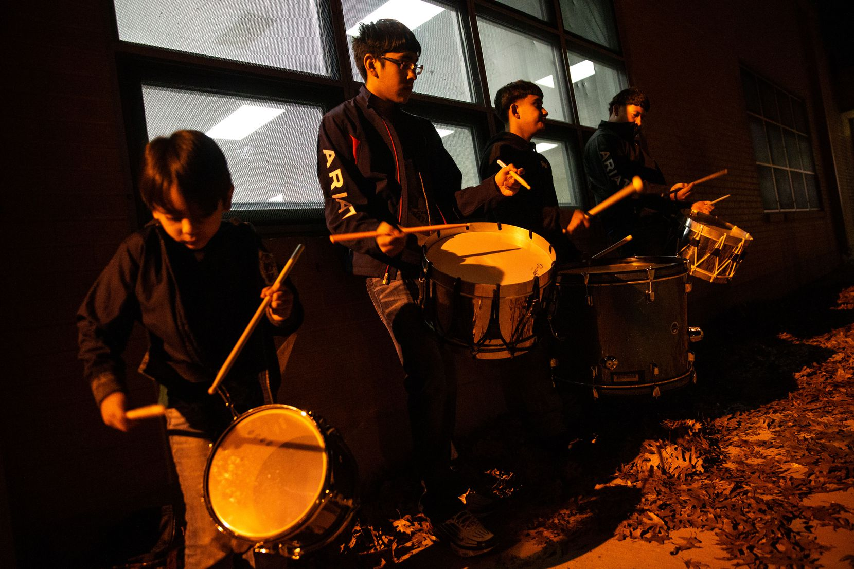 Brothers (from left) Christopher de la Sancha, 7, and Alexander Flores, 15, play the drums with brothers Arnulfo Diaz Jr., 15, and Abraham Diaz, 21, to keep rhythm for Danza Chichimeca San Miguel de Arcángel members.