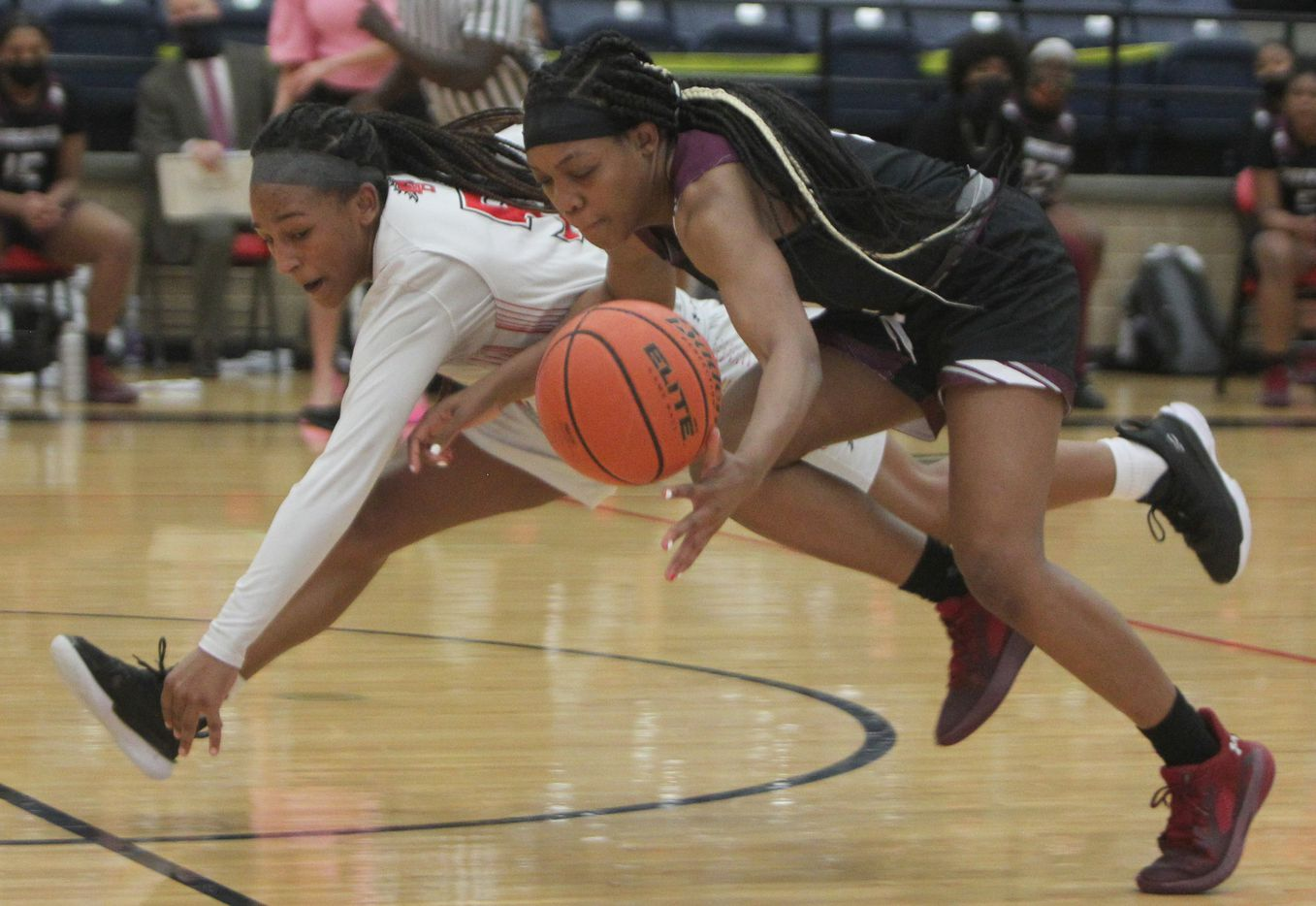 Mansfield Legacy guard Savannah Catalon (5), left, battles with Mansfield Timberview guard Chrishawn Coleman (12) for ball possession during 2nd half action. The two teams played their District 8-5A girls basketball game at Mansfield Legacy High school on January 22 , 2021. (Steve Hamm/ Special Contributor)