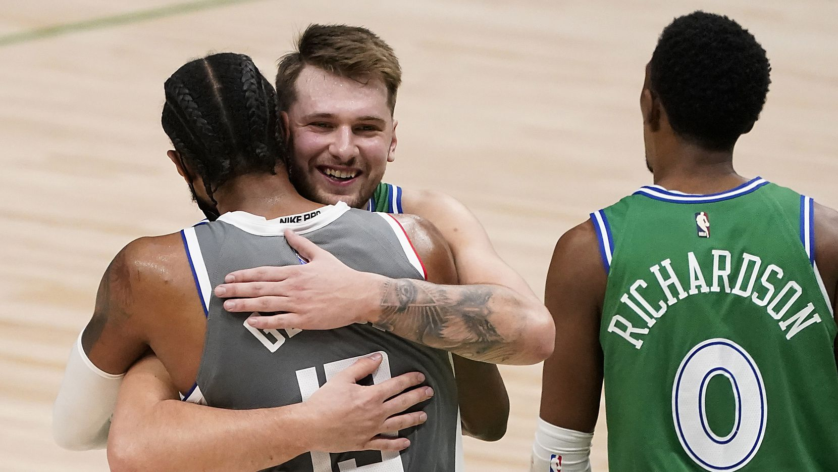 Mavericks guard Luka Doncic hugs Clippers guard Paul George after the Mavs' 105-89 win at American Airlines Center on Wednesday, March 17, 2021, in Dallas.