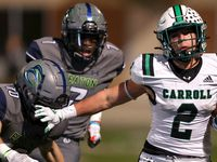 Southlake Carroll running back Owen Allen (2) gives a stiff arm to Eaton safety Aric Wood (10) during the first half in a District 4-6A high school football game played at Northwest ISD Stadium on Thursday, October 21, 2021, in Justin. (Steve Nurenberg/Special Contributor)