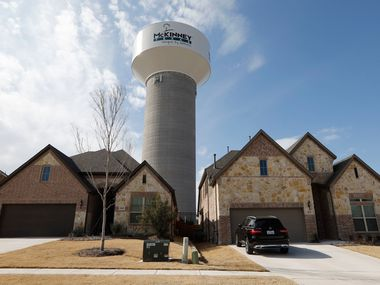 A McKinney water tower looms behind new homes on Leadville Way.