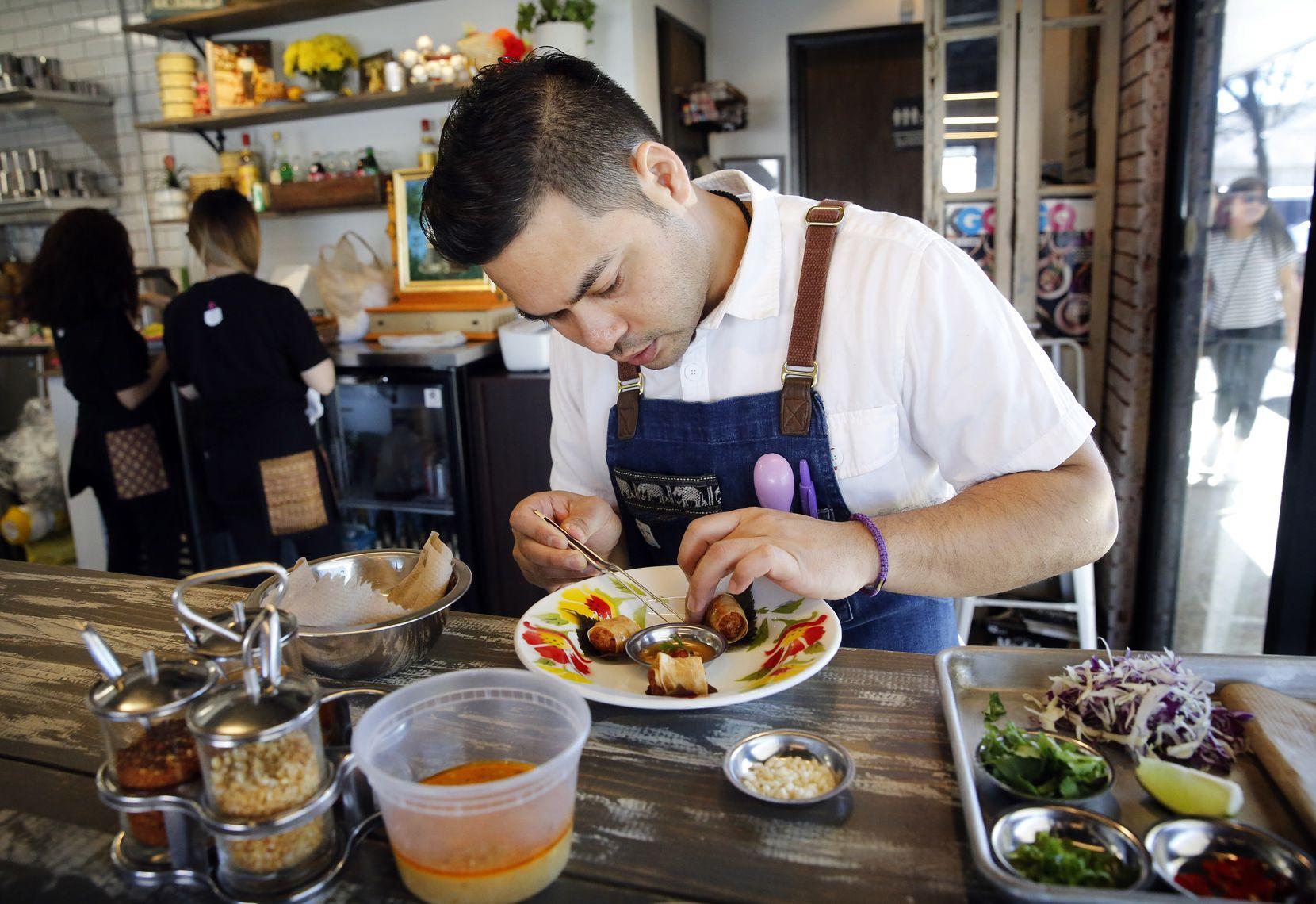 Chef and owner Donny Sirisavath prepares shrimp bites at his Khao Noodle Shop.