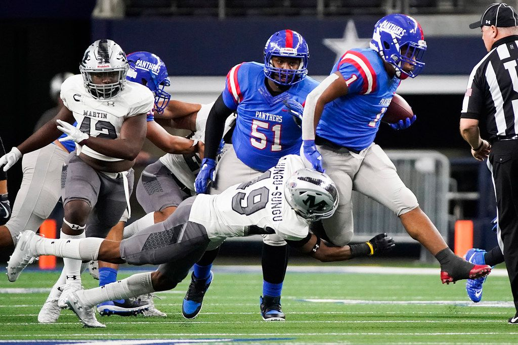 Duncanville running back Trysten Smith (1) tries to get past Arlington Martin defensive back Placide Djungu-Sungu (19) during the first half of a Class 6A Division I Region I semifinal playoff football game at AT&T Stadium on Friday, Nov. 29, 2019, in Arlington.