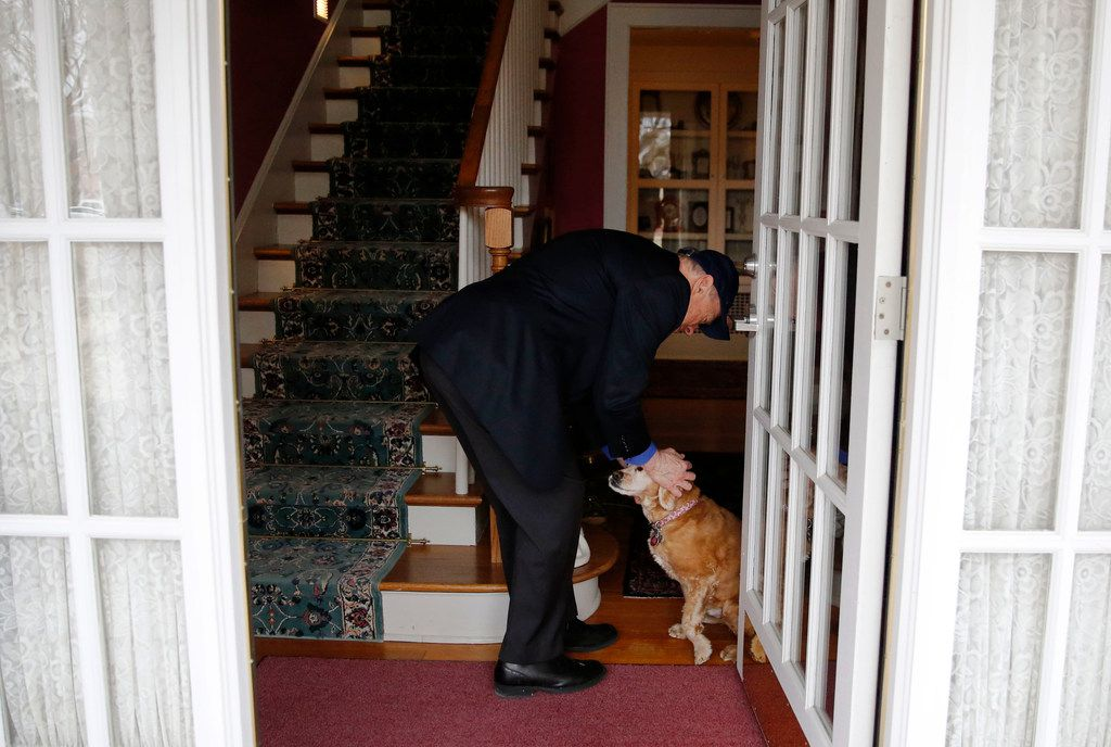 Texas A&M University-Commerce President Ray Keck greets his dog Benny as he walks into his house on campus at Texas A&M University-Commerce.