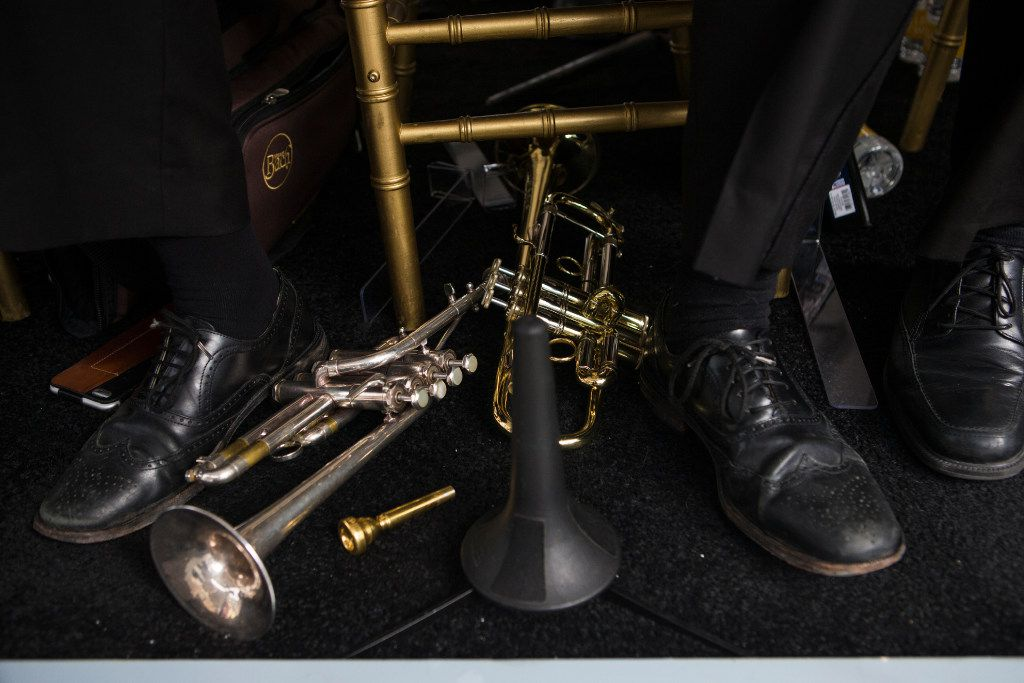 Instruments lay at the feet Plano Symphony Orchestra members during a ribbon cutting ceremony at Legacy West in Plano, Texas on Friday, Jun 2, 2017. (Ryan Michalesko/The Dallas Morning News)