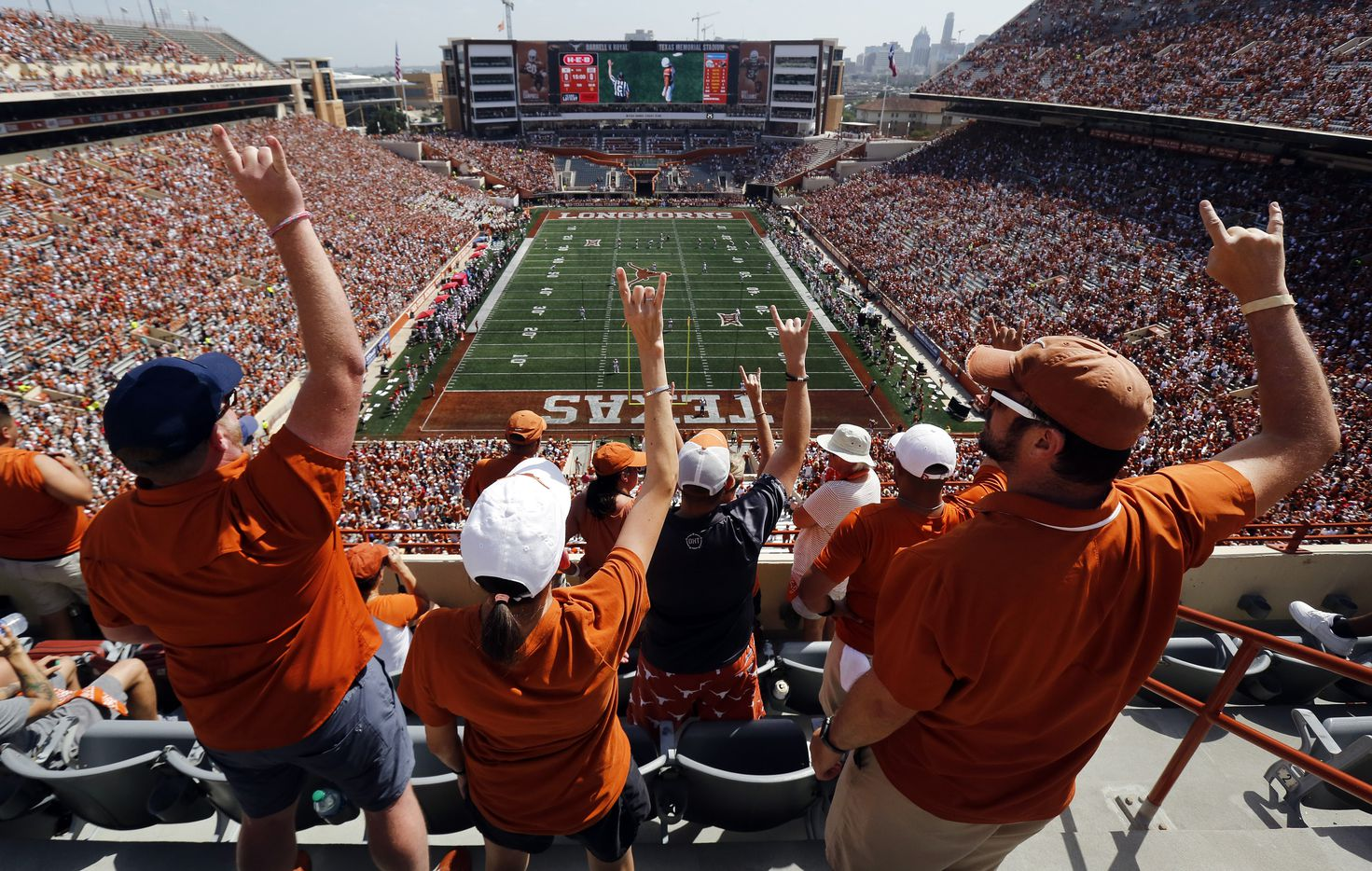 Texas Longhorns fans raise their Hook'em Horns hands as they prepare to kickoff the season against the Louisiana-Lafayette Ragin Cajuns at DKR-Texas Memorial Stadium in Austin, Saturday, September 4, 2021. (Tom Fox/The Dallas Morning News)