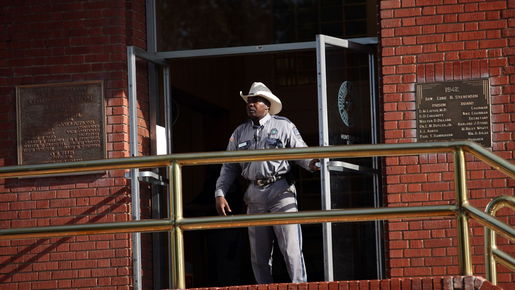 A Texas correction officer keeps watch outside the Texas Department of Criminal Justice Huntsville Unit. The former top spokeswoman for the Texas Department of Public Safety's public information department says she got crosswise with TDCJ administrators because they decided she was too open with the news media, and, by extension, the general public.