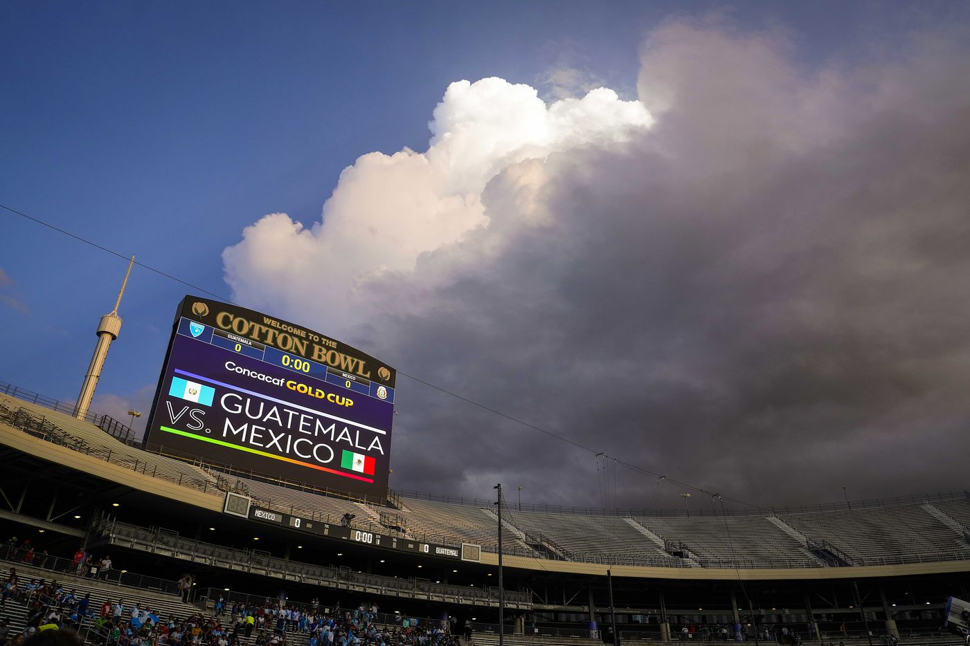 Storm clouds roll over the stadium before a CONCACAF Gold Cup Group A soccer match at the Cotton Bowl between the Mexico and the Guatemala on Wednesday, July 14, 2021, in Dallas. The start of the game was delayed due to weather.