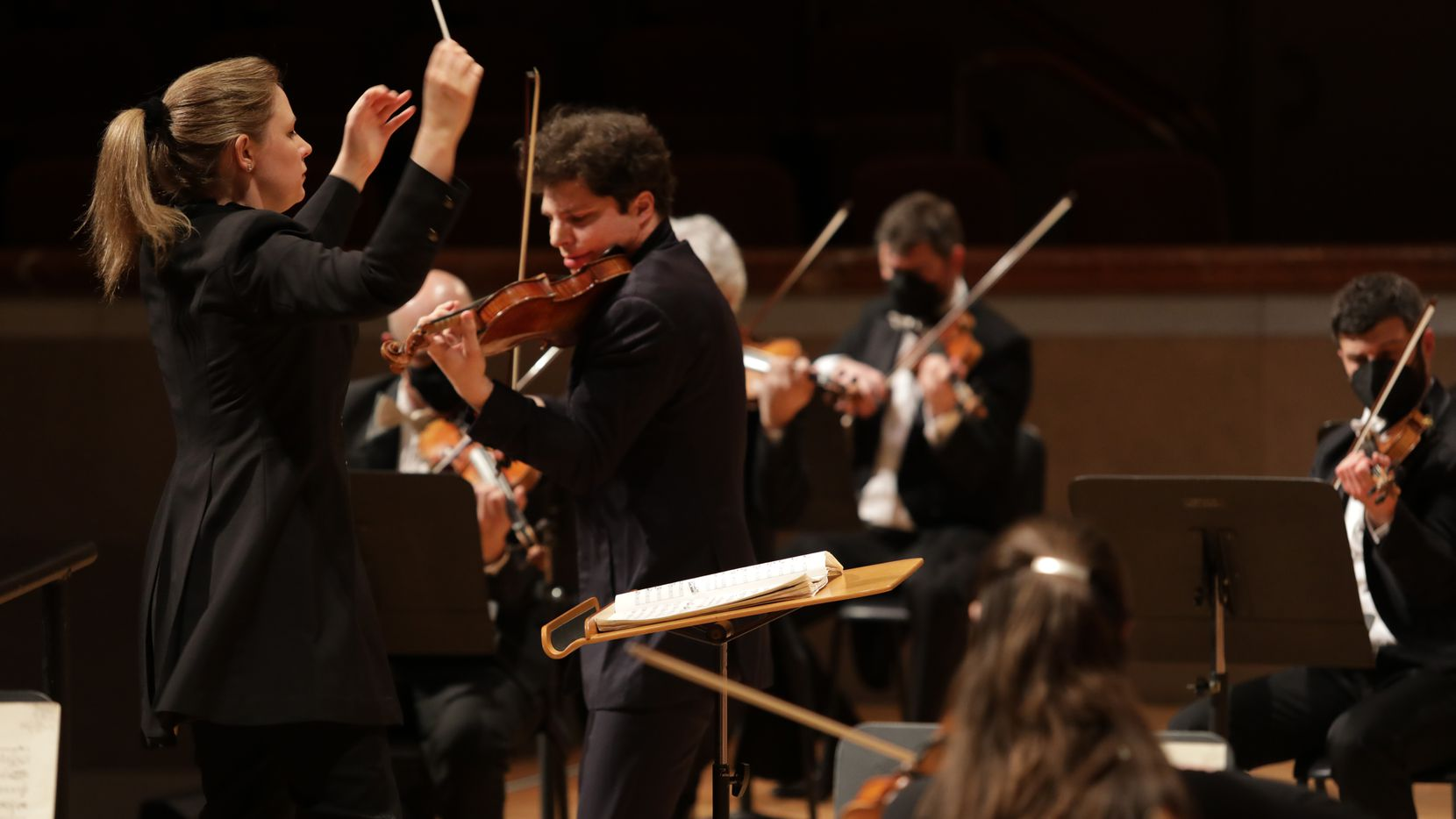 Principal guest conductor Gemma New (left) and violin soloist Augustin Hadelich perform during a Dallas Symphony Orchestra concert at the Meyerson Symphony Center.