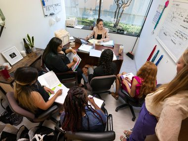 Madison Kitchen, behind her desk, hosts a meeting in her Lumos Marketing Group office in Far North Dallas.  As of July, the Dallas-Plano-Irving subway division had recovered nearly 99% of the jobs lost during the pandemic - long before the national recovery.
