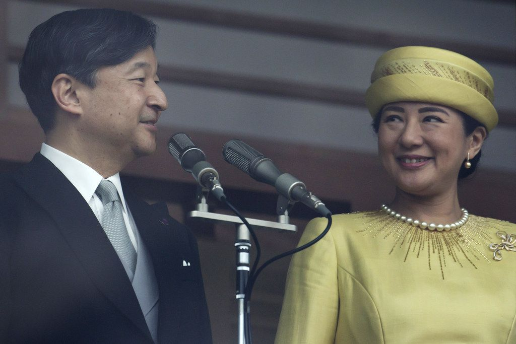 Japan's Emperor Naruhito and Empress Masako stand on from the balcony of the Imperial Palace on May 4, 2019, in Tokyo. Emperor Naruhito has made his first official public appearance following his ascension to the Chrysanthemum Throne last week after his father abdicated, citing ill health.