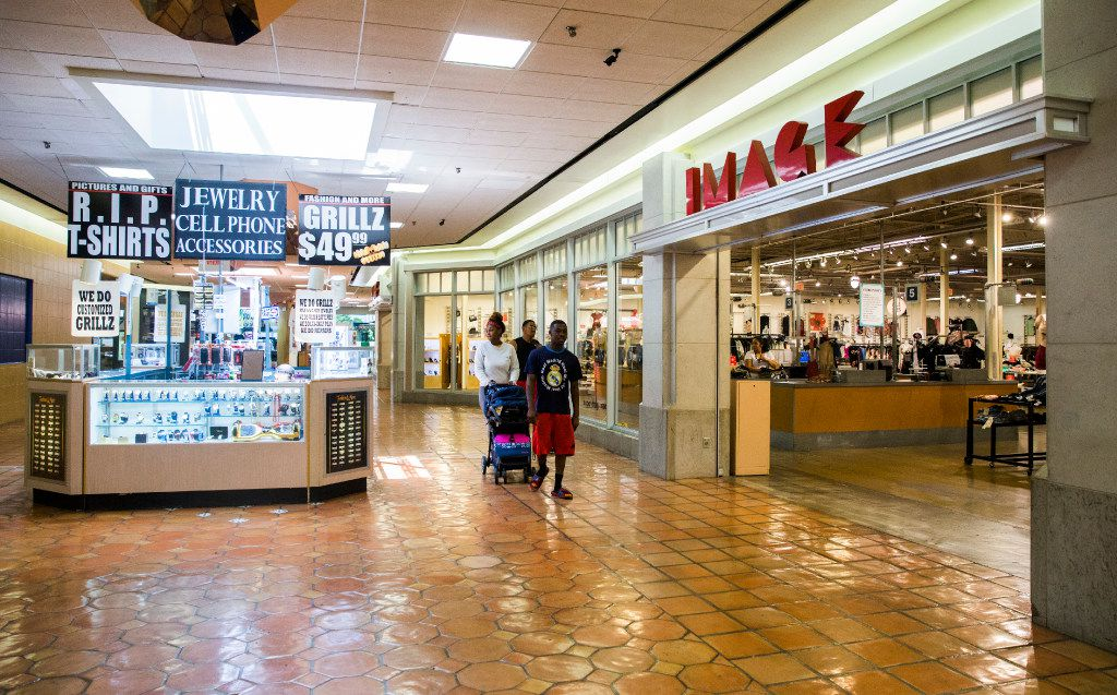 Shoppers walk on the second floor of Southwest Center Mall, which will undergo major renovations and be renamed Redbird Mall.