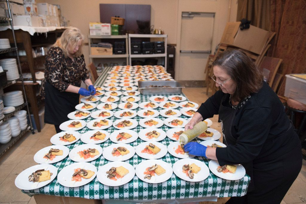 Tina Neal, left, and Semira Pacifico finish plating polenta crostinis with mushrooms.   (Rex C. Curry/Special Contributor)