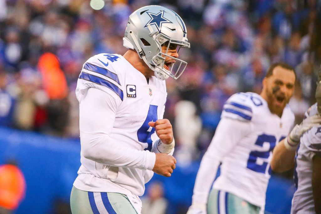 Dallas Cowboys quarterback Dak Prescott (4) celebrates after scoring a two points conversion to take the lead in the last two minutes an NFL football game at MetLife Stadium in East Rutherford, New Jersey on Sunday, Dec. 30, 2018. (Shaban Athuman/The Dallas Morning News)