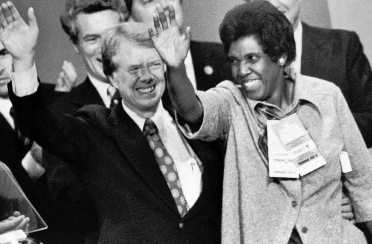 Representative Barbara Jordan, D-Texas, joins Democratic presidential nominee Jimmy Carter at the podium after Carter's acceptance speech at the Democratic National Convention in New York City, July 16, 1976.